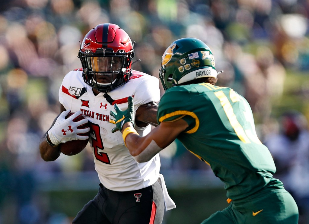 Texas Tech's RJ Turner (2) pushes away Baylor's Raleigh Texada (13) during the game Saturday, Oct. 12, 2019, at McLane Stadium in Waco, Texas. [Brad Tollefson/A-J Media]