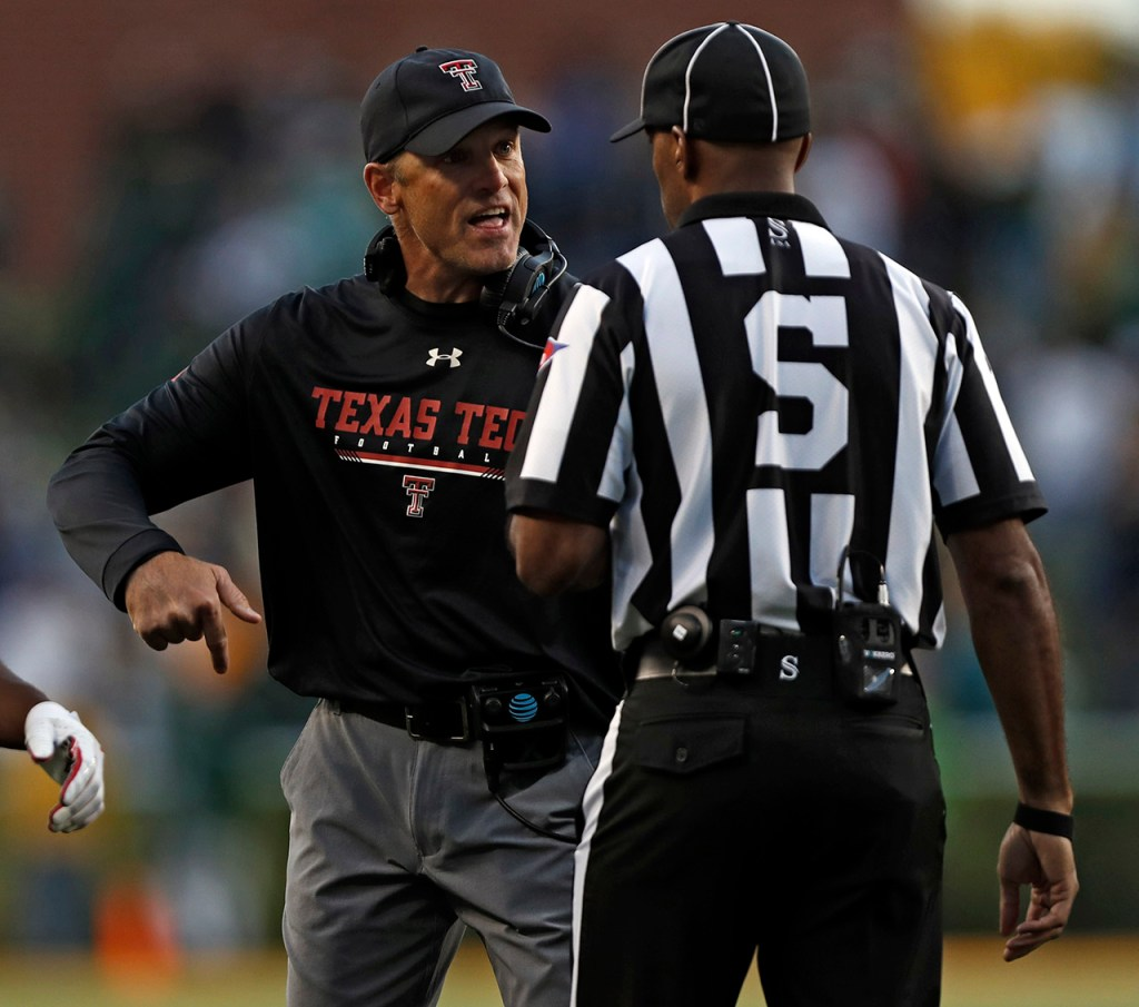 Texas Tech coach Matt Wells argues a call with referee Tuta Salaam during the game against Baylor, Saturday, Oct. 12, 2019, at McLane Stadium in Waco, Texas. [Brad Tollefson/A-J Media]