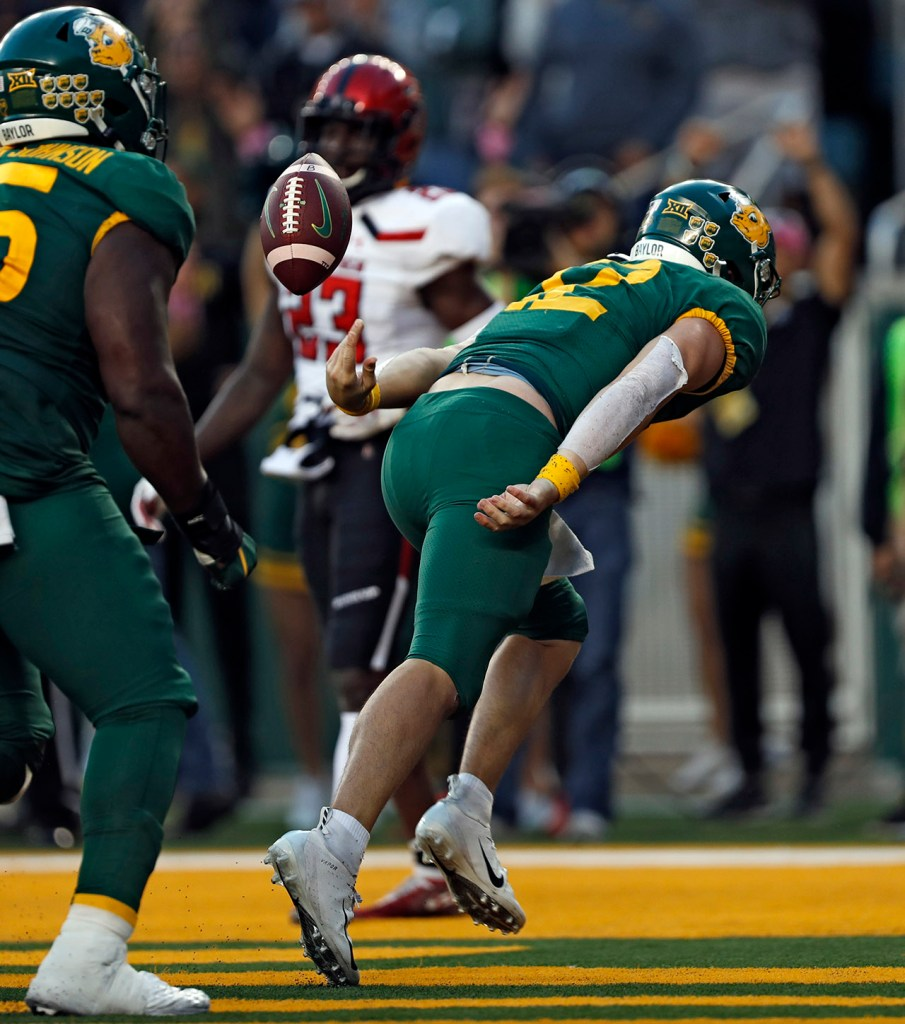 Baylor's Charlie Brewer (12) scores a touchdown in overtime during the game against Texas Tech, Saturday, Oct. 12, 2019, at McLane Stadium in Waco, Texas. [Brad Tollefson/A-J Media]