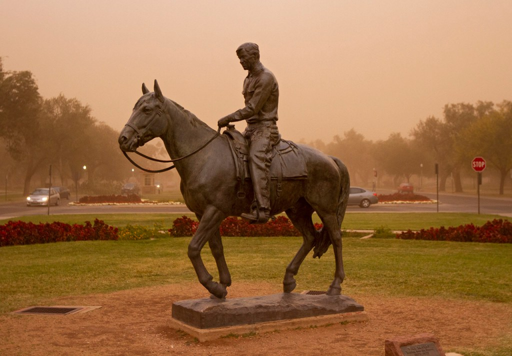 Dust blows in the wind around the statue of Will Rogers and Soapsuds during a kabob Monday, Oct. 17, 2011, in Lubbock, Texas. (Brad Tollefson/The Daily Toreador)