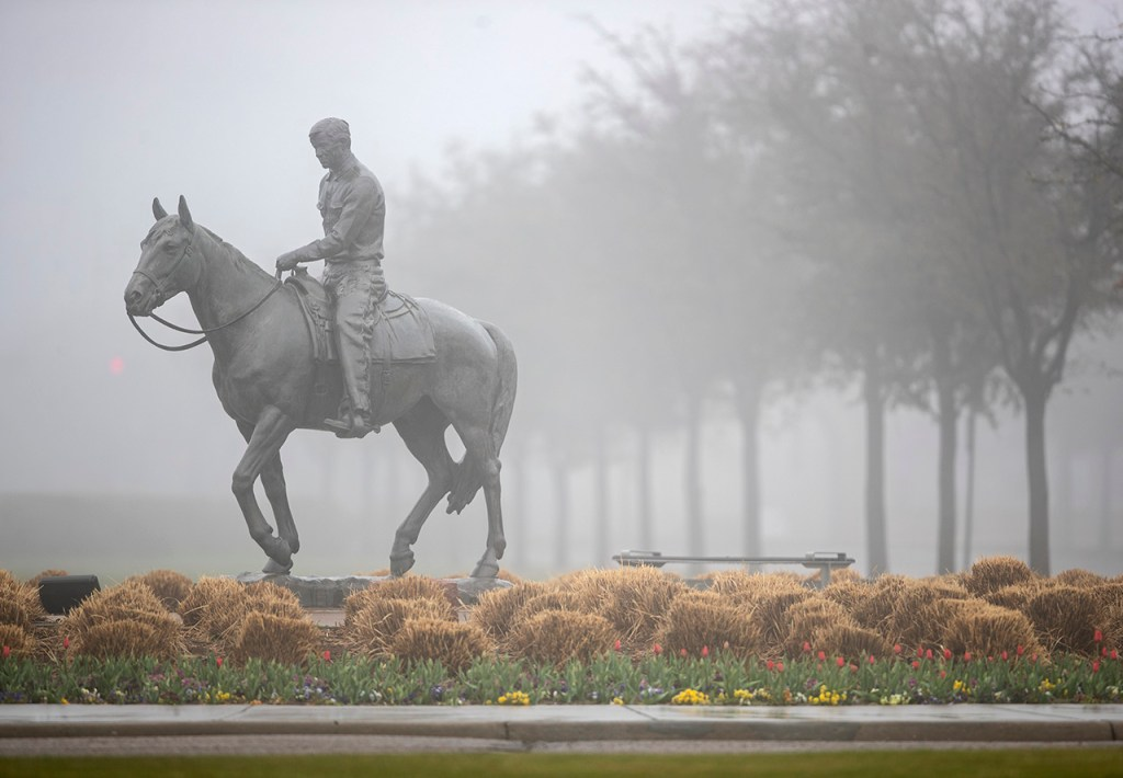 The statue of Will Rogers and Soapsuds is surrounded by fog and mist Tuesday, March 12, 2019, in Lubbock, Texas. [Brad Tollefson/Lubbock Avalanche-Journal]