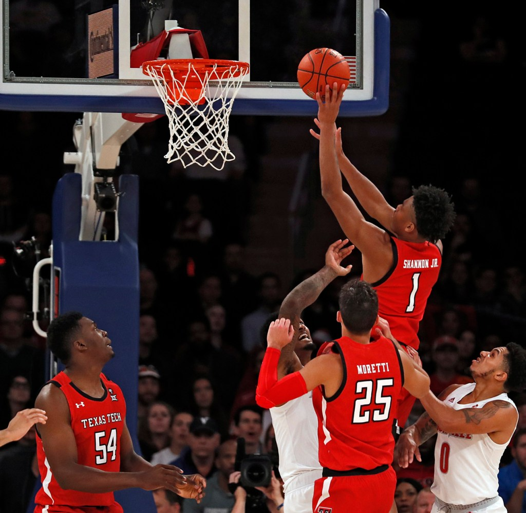 Texas Tech's Terrence Shannon, Jr. (1) tips in the ball during the first half of the Jimmy V Classic game Tuesday, Dec. 10, 2019, at Madison Square Garden in New York, N.Y. [Brad Tollefson/A-J Media]