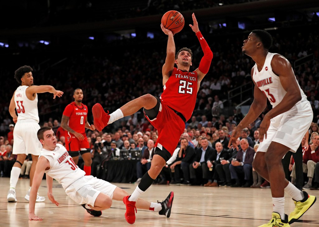 Texas Tech's Davide Moretti (25) shoots the ball after being fouled by Louisville's Ryan McMahon (30) during the second half of the Jimmy V Classic game Tuesday, Dec. 10, 2019, at Madison Square Garden in New York, N.Y. [Brad Tollefson/A-J Media]