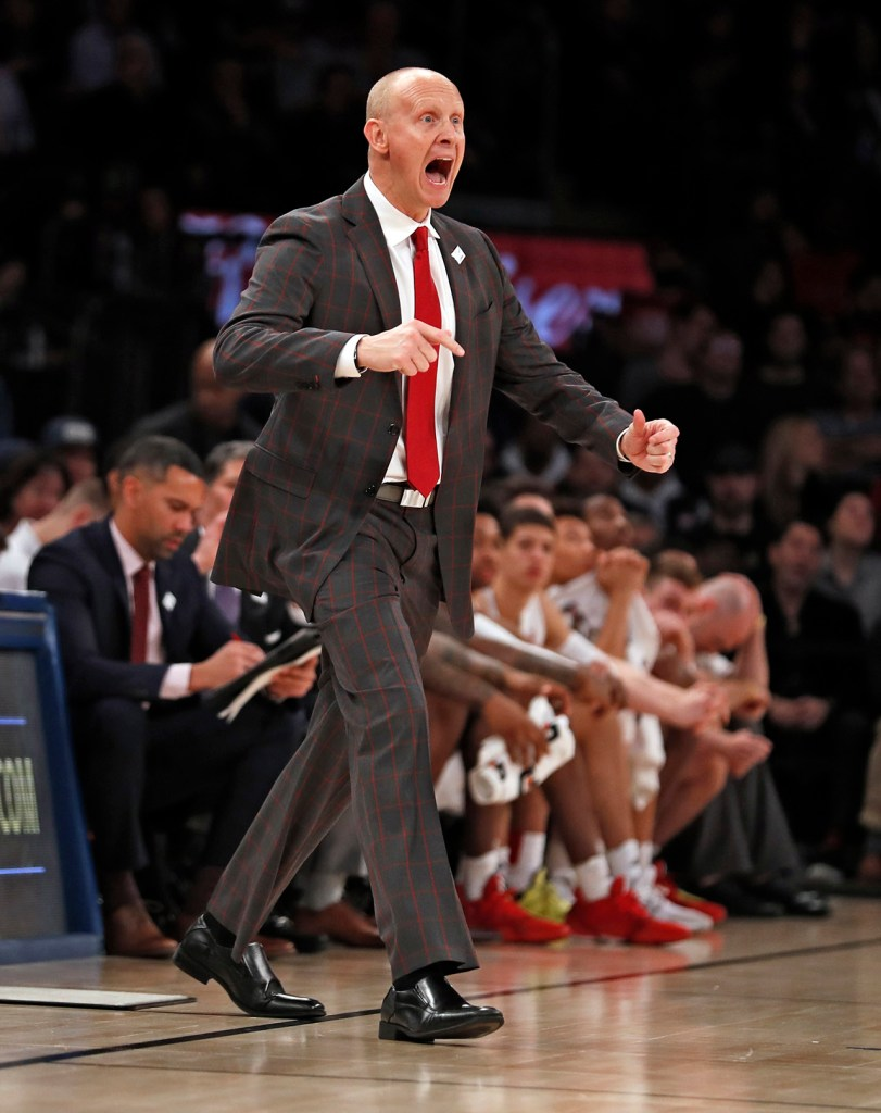 Louisville coach Chris Mack reacts after a foul call during the second half of the Jimmy V Classic game Tuesday, Dec. 10, 2019, at Madison Square Garden in New York, N.Y. [Brad Tollefson/A-J Media]