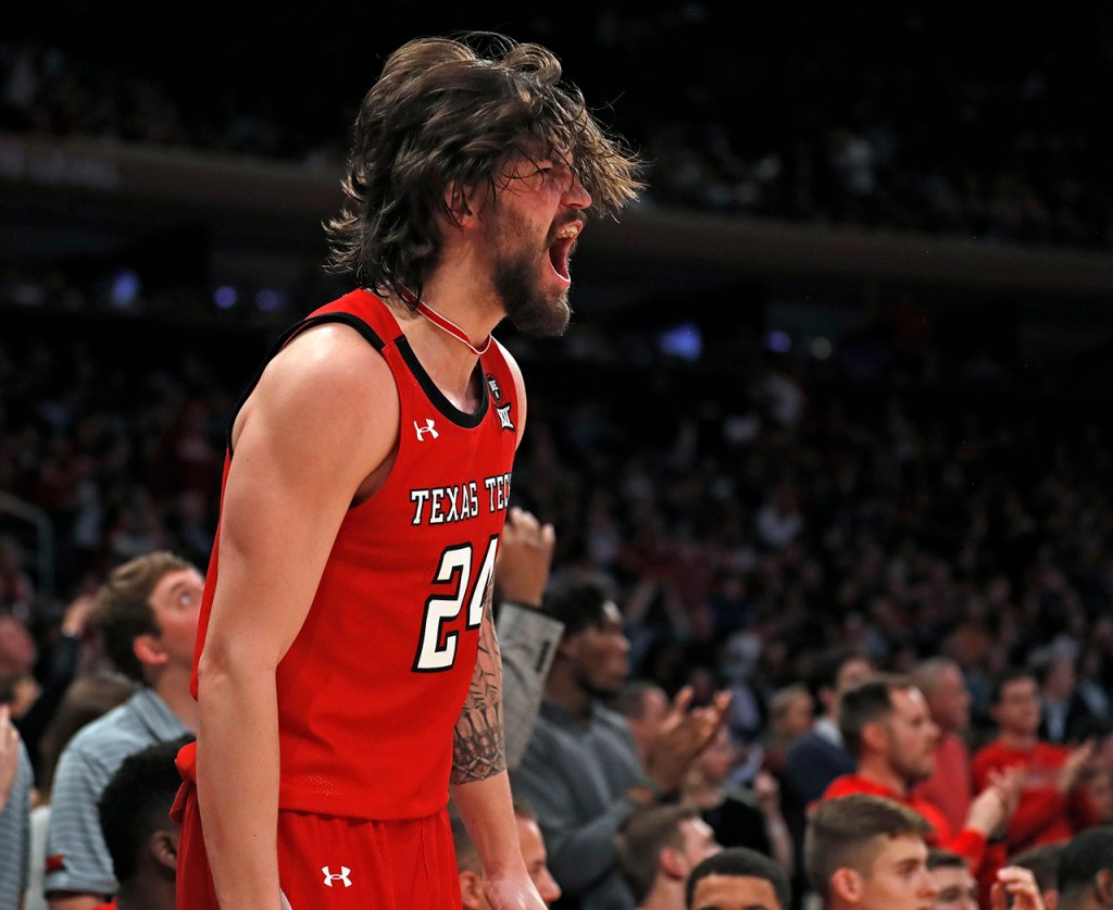 Texas Tech's Avery Benson (24) cheers from the bench during the second half of the Jimmy V Classic game Tuesday, Dec. 10, 2019, at Madison Square Garden in New York, N.Y. [Brad Tollefson/A-J Media]