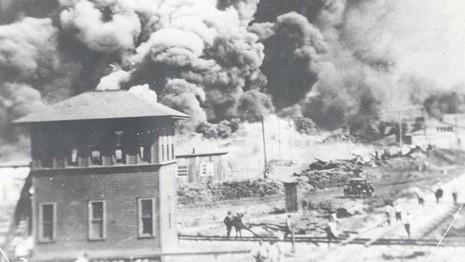 Tulsa, Oklahoma burns during the race massacre of 1921.