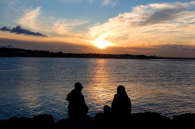 couplelovers at serene calm peace sea sunset sunrise