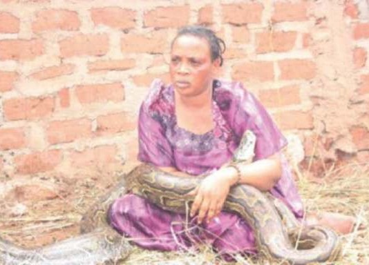 More Photo Of The Woman Caught Breastfeeding A Snake