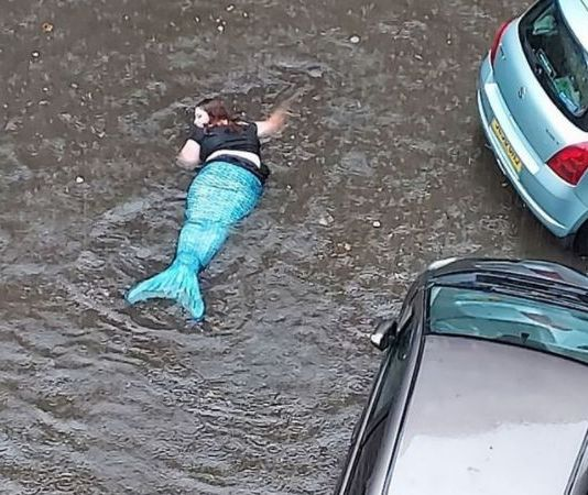 See Photos As 'Mermaid' Is Spotted Swimming During Floods