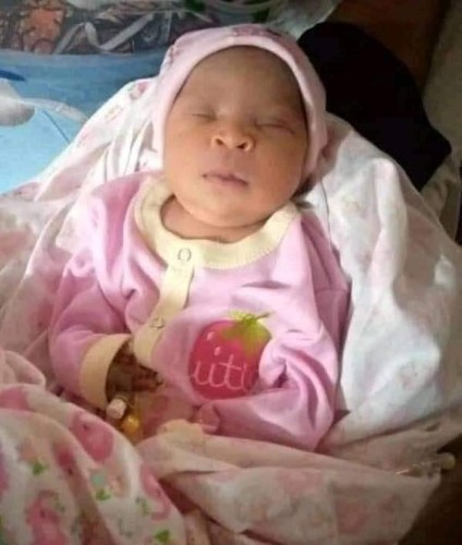 See Photos As Mad Woman Delivers Twins In Delta State