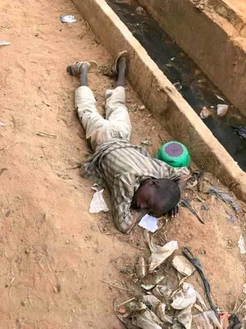 Nigerian Child Sleeping On A Pile Of Dirt In The North