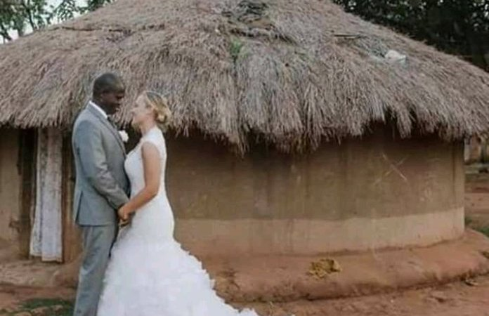 [PHOTOS] Canadian Tourist Marries African Man Whose Wife Abandoned Him With 7 Kids Over Poverty