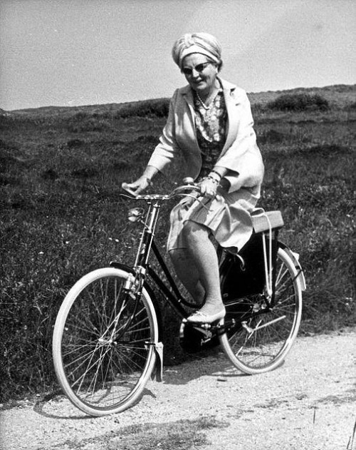 Pedaling Progress: The Dutch Queen Juliana Riding a Bike