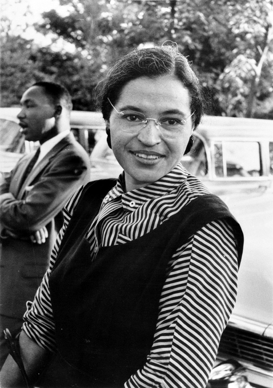 Rosa Parks in 1955, the year of her arrest, with Martin Luther King, Jr. in the background