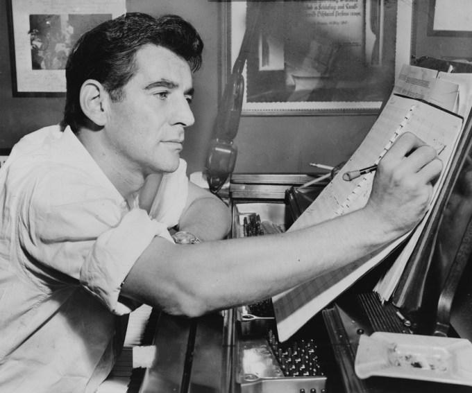 Leonard Bernstein making notes at the piano, 1955 (Photograph: Al Ravenna / Library of Congress)