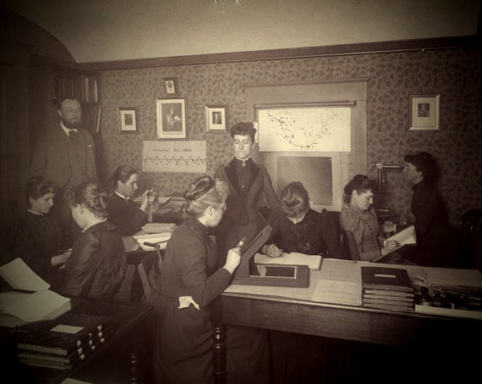 "Williamina Fleming (standing) presiding over the ""Harvard computers,"" circa 1890. (Harvard University Archives)"