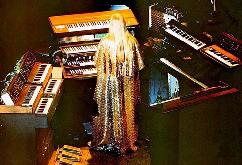 Rick Wakeman of Yes. I could see myself playing all those keyboards and wearing a cape.