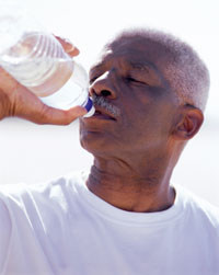 Photo: Man drinking bottled water