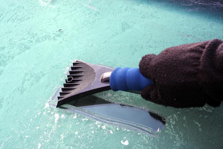 scraper on windshield