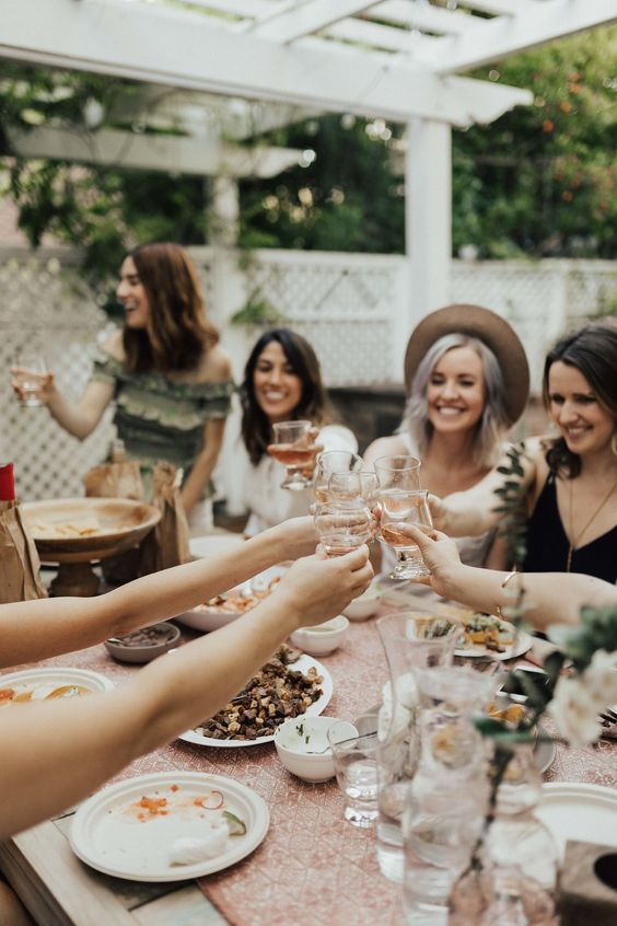 Ladies eating food and celebrating