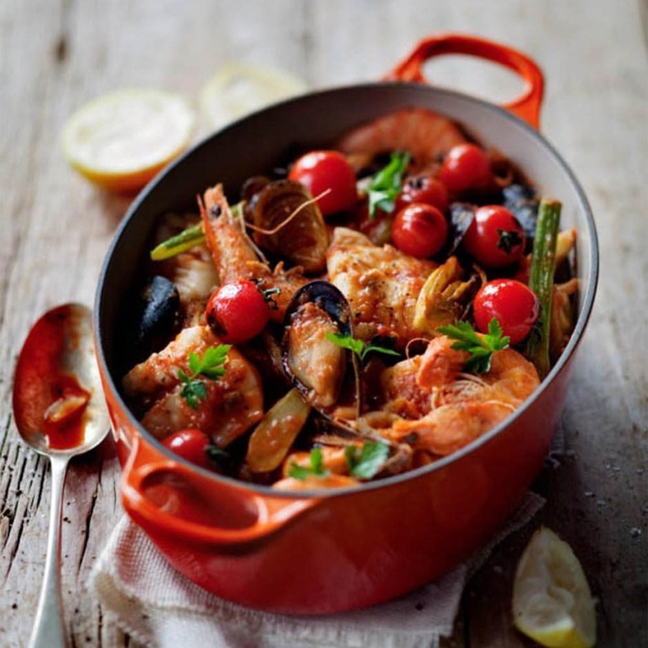 Le Creuset orange volcanic casserole dish with seafood stew recipe