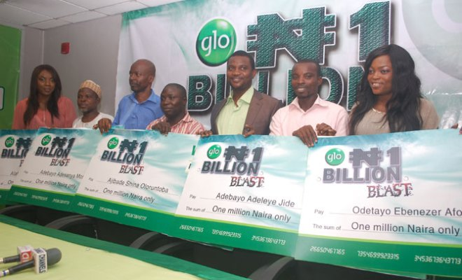 Some of the winners of N1 million each in the Glo N1 Billion SIM registration promo pose with Glo ambassadors Chioma Chukwuka Akpotha and Funke Akindele at a presentation ceremony held at Globacom headquarters in Lagos .