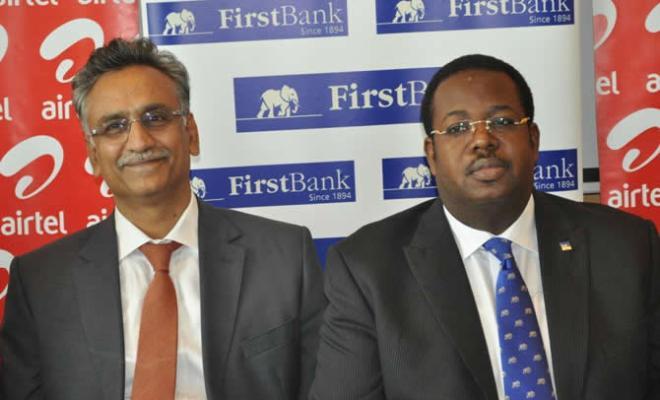 Mr. Rajan Swaroop, Managing Director/Chief Executive Officer, Airtel Nigeria with Mr. Bisi Onasanya, Managing Director/Chief Executive Officer First Bank Nigeria