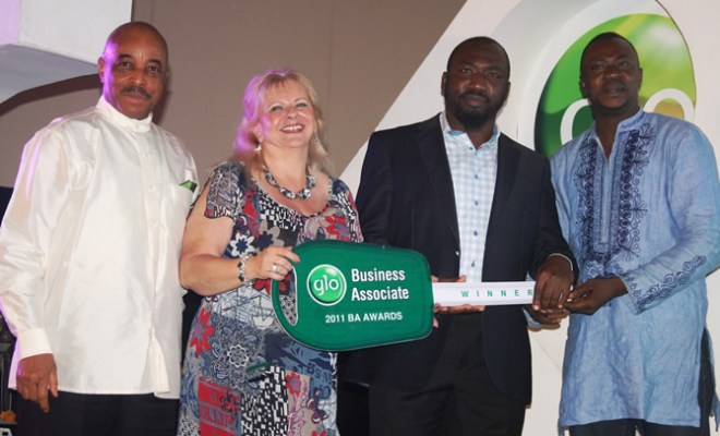 GLO REWARDS DEALERS: Globacom's Executive Director, Mr. Adewale Sangowawa (left) and the Director of Customer Care, Ms. Maria Svensson presenting the key of the latest Range Rover Sports HSE to the Glo Best Performing Business Associate Nationwide, Alhaji Mohammed Anthony at the Glo 2011 Business Associate Awards held at Eko Hotel & Suites over the weekend to reward the company's outstanding dealers. With them is a Glo Ambassador, Odunlade Adekola. (right)