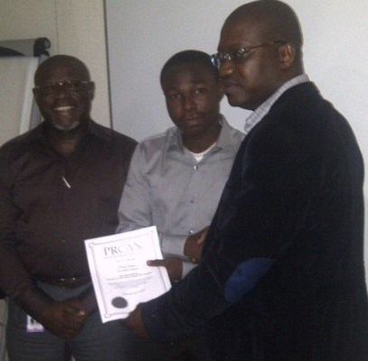 Akonte Ekine. MD, Absolute PR and a facilitator at the workshop, and John Ehiguese, Secretary General PRCAN, presenting certificate to a participant.