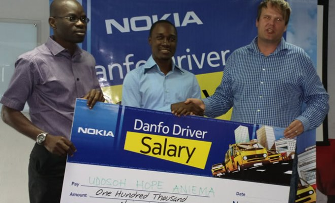 (L-R) Olajide Adeyemi, Retail Manager, Nokia West-Africa, One of the Winners of N100,000.00 of Nokia Danfo Reloaded Competition, Udosoh Aniema, and Teemu Kijaarvi, Head, Developer Experience , Nokia West Africa, at the prize presentation for the first draw of Nokia Danfo reloaded competition, held at Nokia office, Victoria Island,