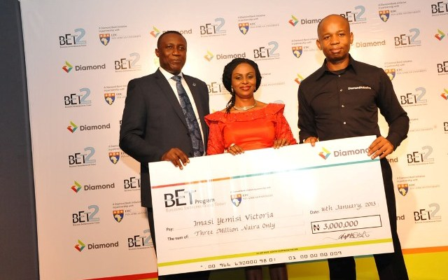 Jude Anele, Head Retail Banking Diamond Bank Plc, Mrs. Imasi Yemisi Victoria, CEO Yellow-Point Media; one of the five outstanding entrepreneurs of the Diamond Bank's'Building Entrepreneurs and Uzoma Dozie, ED, Lagos/West Business Diamond Bank.