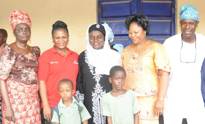 L-R, Assist head teacher, Mrs. Oguntoye, COO, Berkley Academy with Kosofe LG Excos and little Scholaship Winners, Promise and Haisat, during Berkley Community Service Programme 2013