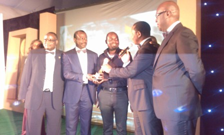 "Garba Bello-Kankarofi, APCON Registrar/CEO, (Left); David Okeme, Brand Building Director, Unilever Plc and Dexter, Brand Manager, Close-Up, receiving the award for ""Brand Manager of the Year"" from Kola Oyeyemi, ADVAN President and Lolu Akinwunmi, APCON, Chairman at the ADVAN 2013 Awards for marketing Excellence at the Federal Palace Hotel, Lagos on Saturday."