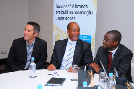 Business Development Director, Ricardo Gressel sharing a good laugh with guest speaker, Lanre Oke, Owner of Elbeo. CEO of TBU MEA, Hermann Behrens awaits his turn at the podium.