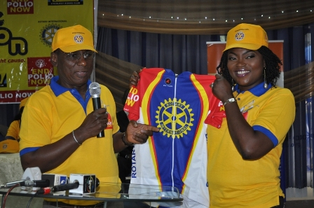 STAR ACTRESS, FUNKE AKINDELE (a.k.a Jenifa) BEING UNVEILED AS ROTARY POLIO eradication AMBASSADOR BY DR TUNJI FUNSHO, CHAIRMAN, NIGERIA NATIONAL POLIO PLUS COMMITTEE AT THE BIKE A THON PRESS CONFERENCE