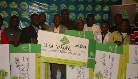 """The winner of N5million in the ongoing Glo """"text4millions""""promo, Luka Yakubu, a pastor with the Redeemed Christian Church of God (middle) flanked by other lucky winners during the prize presentation ceremony held in Abuja on Thursday"""