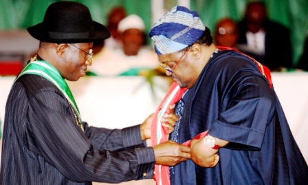 President Goodluck Jonathan (left) decorates Chairman, Globacom Limited, Mike Adenuga Jnr with the Grand Commander of the Niger (GCON) title at the National Honours Awards 2012 held in Abuja