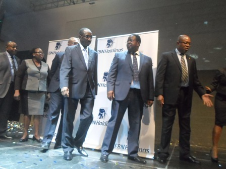 3rd and 2nd right, CEO, FBN Holdings, Mallam Bello Maccido and CEO, First Bank Plc, Mr. Bisi Onasanya flanked by other key officials of FBN Holdings