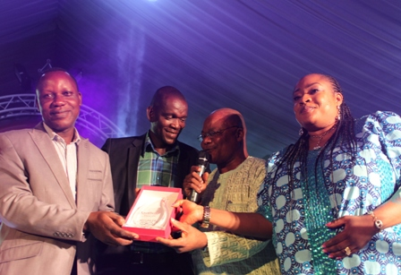 (R-L) Star actress, Foluke Daramola and Chairman Ifako-Ijaiye LCDA, Hon. Toba Oke jointly presenting the award plaque to Managing Director, PRRedline, Lekan Ishola whose agency emerged Best PR Agency of the Year at the Excellence Recognition Awards held at the Haven Events Place in Lagos on Sunday while Senior Executive, Media Relations, PRRedline, Eric Eghaghe watches in the background