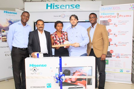 "(L-R) Treasury Manager, Dajcom, Okunnu Olayemi; Country Director, Hisense , Jacob Chacko; the winner, Somma Phillips being presented with a 55"" Hisense Smart Edge-Lit LED TV, Managing Director, Dajcom, Mr. David Safa and Damola Bamgboye of BlackSheep at the presentation of prize to the winner of the ""Hisense Then and Now Challenge"" in Lagos."
