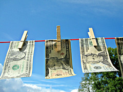 Money Laundering - Dollars, by Images Money