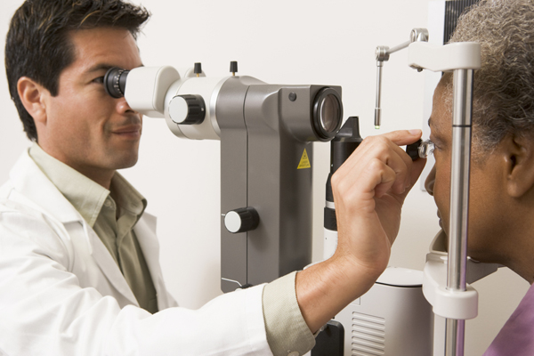 eye doctor and patient at exam