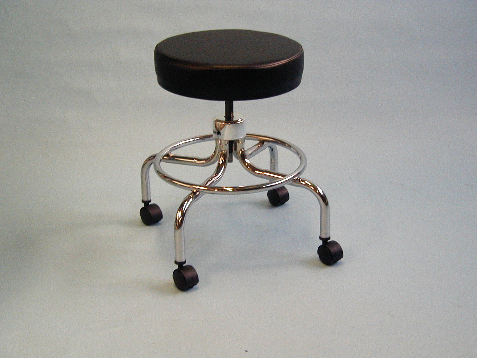 revolving chair for doctor ashley table and chairs brandt industries stools stool