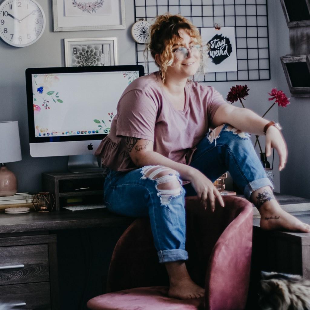 Brittany DeMauro Sitting On Desk