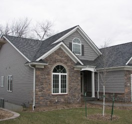 gray home rock facade dark cedar shake color