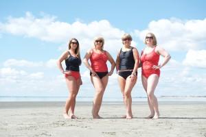 mastectomy swim models on a beach