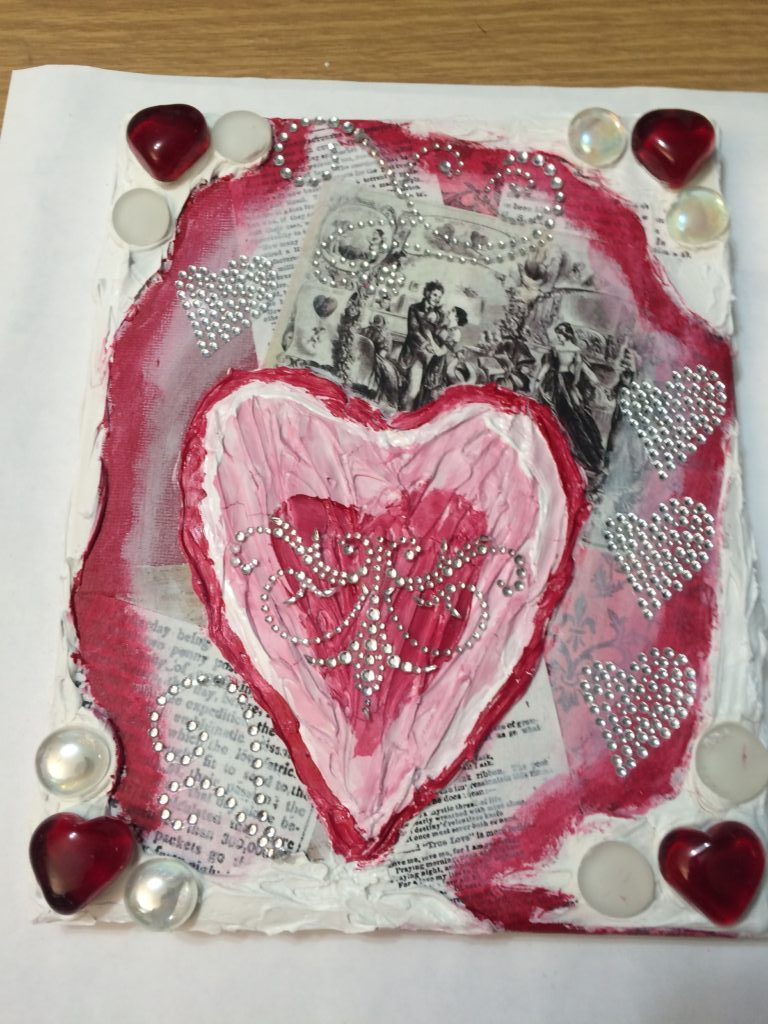 Valentine's Day mixed media project_red and pink heart over collage