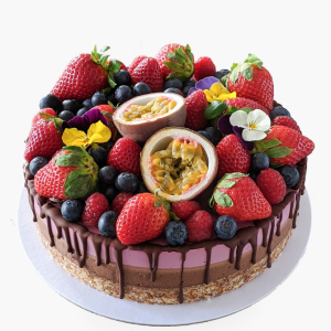 Statement cake with fresh fruit and chocolate dripping