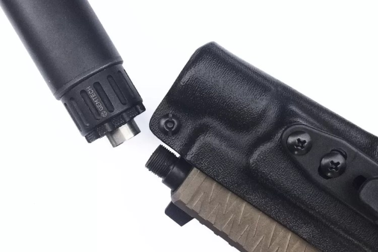 The X-Fer V2 suppressor holster holds the suppressed pistol via the weapon light, in this case the Gemtech Aurora.