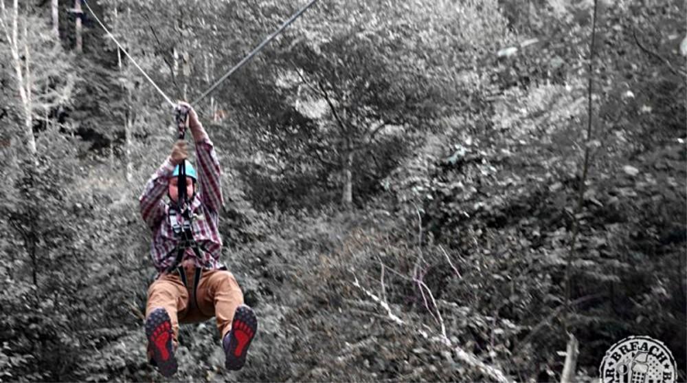 Ryan's adventures wearing the Lone Peak 3.5 Mid Mesh shoes include ziplining.